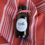 little-bottle-on-red-fabric
